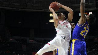 Cajuns Forward Kobe Julien goes for a contested shot in the lane on Saturday against McNeese State. Photo courtesy of Clint Domingue